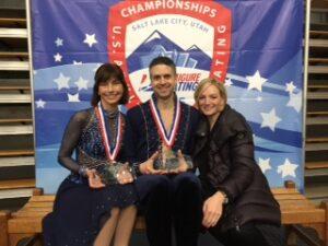 Susan Dumont and John Weistein with coach Kristen Fraser displaytheir National Championship crystal!