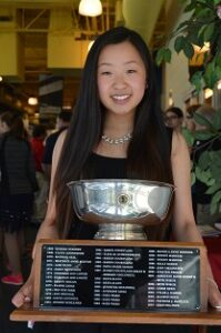 Tiffany Wu holding the Kern Trophy. This is the second year Tiffany has earned the award!